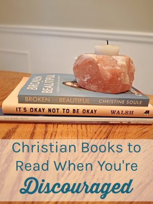 """Image of 4 books stacked on a table. Text overlay reads: """"Christian Books to Read When You're Discouraged"""""""